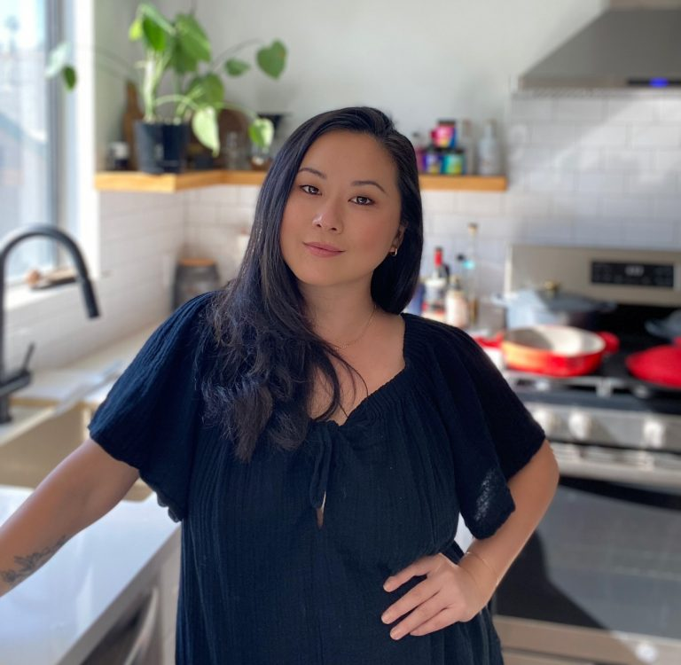 Photograph of Fly by Jing Founder Jing Gao standing in her kitchen
